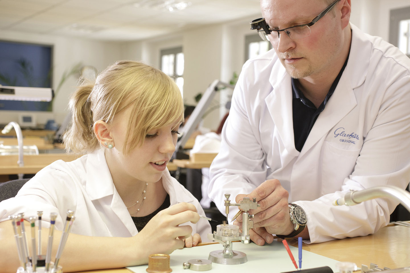 watchmaking-student-with-teacher